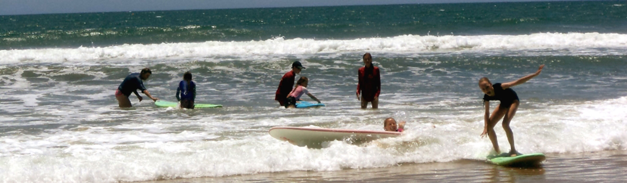 Mapleton State School students surfing at the beach
